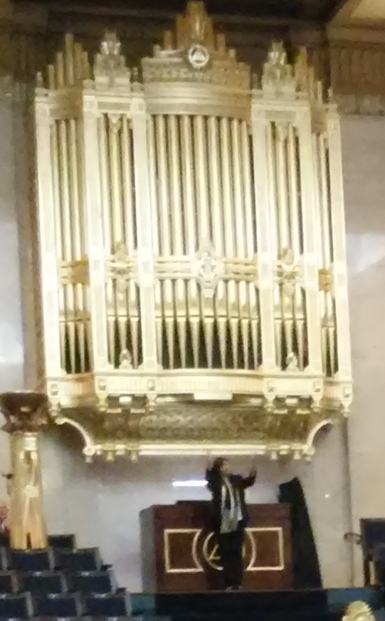 Jane Parker-Smith taking applause after her recital at Freemasons Hall, London WC2, on 14 December 2016 [detail]