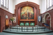 St Aldhelm's church, London N18, by W. D. Caröe (1903), the sanctuary. The reredos painting of the Ascension is by Walter Percival Starmer (1871–1961).