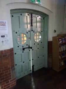 Internal south-west-entrance doors in 2017, St Aldhelm's church, London N18 (W. D. Caroe, 1903).