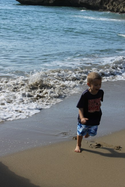 One of Grady's favorite parts - running away from the waves.