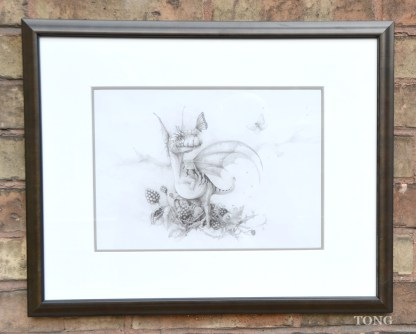 Framed pencil drawing of a tiny dragon sitting in a blackberry bush