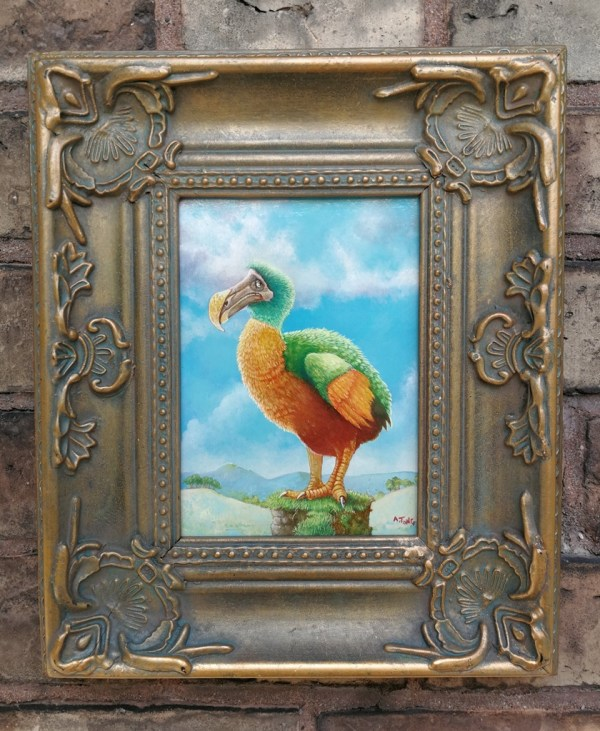 Framed oil painting of dodo bird perched on a small rock