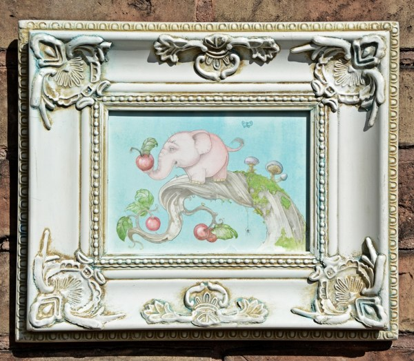 framed artwork of dwarf pink treelephant standing on a branch holding a berry
