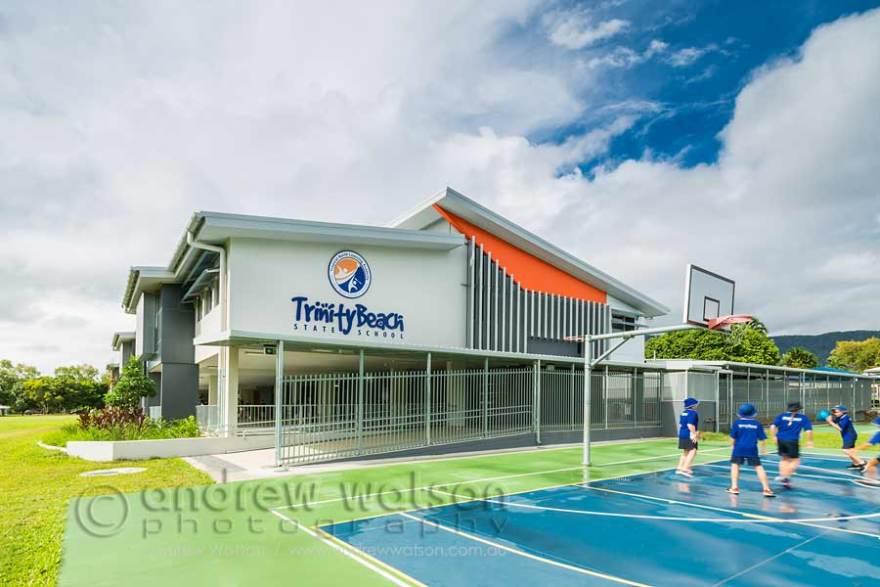 Images of kids playing basketball in front of new Cairns building