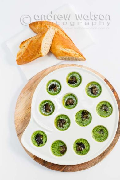 Image of snails cooked in garlic parsley butter with a baguette