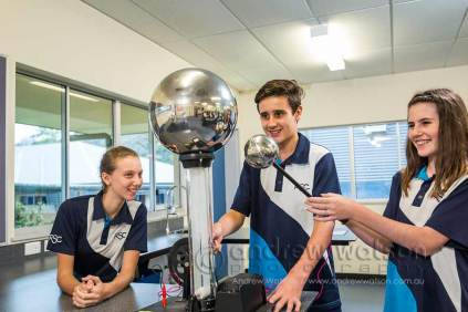 Image of school students working with an electrostatic generator