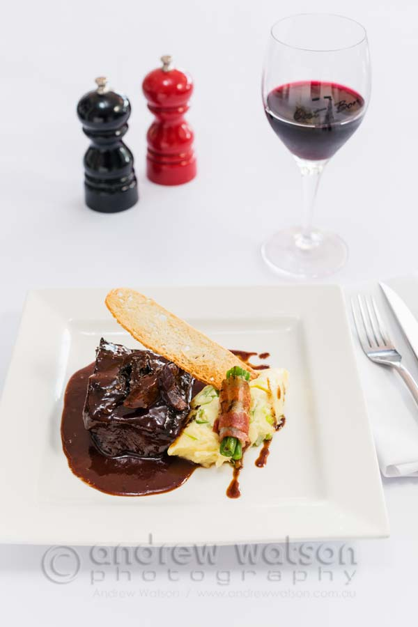 Image of Braised red wine beef cheek dish served with potato mash