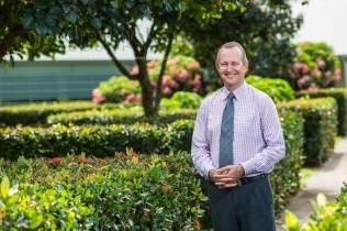 Image of school principal in gardens
