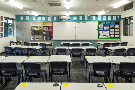 Image of school desks in an empty classroom