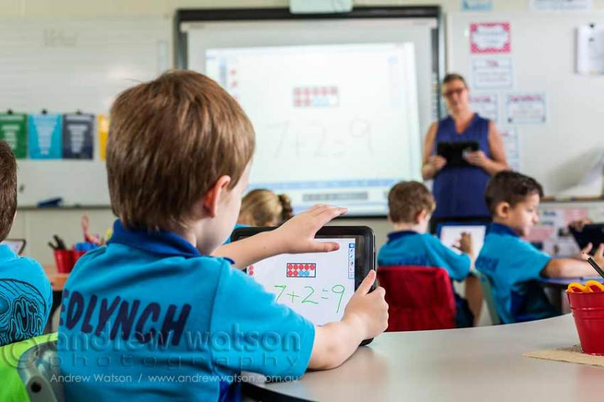 Image of student using iPad in the classroom