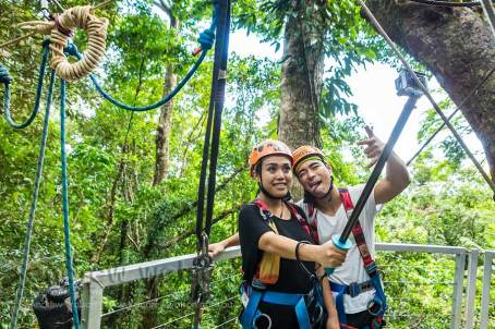 Asian couple with self-stick on Daintree rainforest ziplining tour
