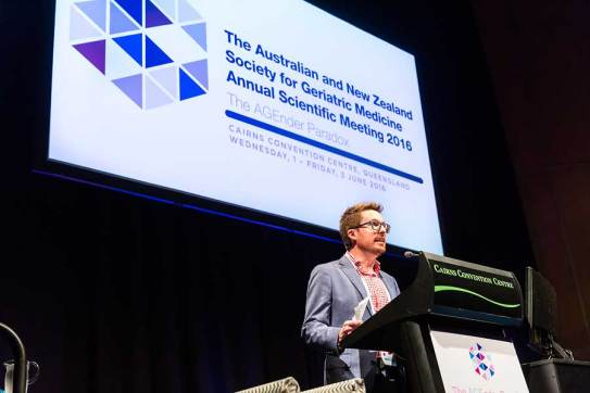 Image of conference MC during plenary sessions of ANZSGM 2016