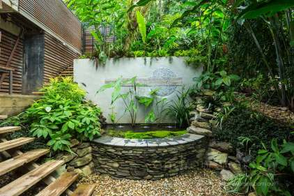 Image of water fountain in a residential tropical garden in Port Douglas