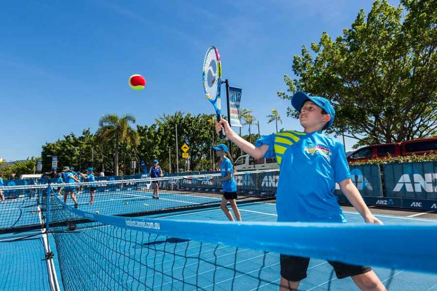 Image of kids in action at ANZ ennis clinic in Cairns
