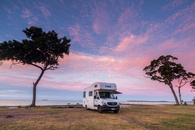 Image of campervan parked beside seaside at Clairview Beach