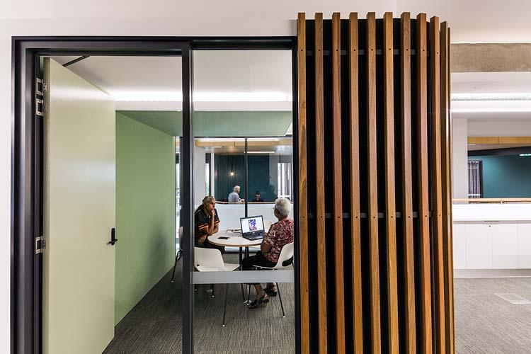 Staff talking in meeting room in Bulmba-ja Arts Centre, Cairns