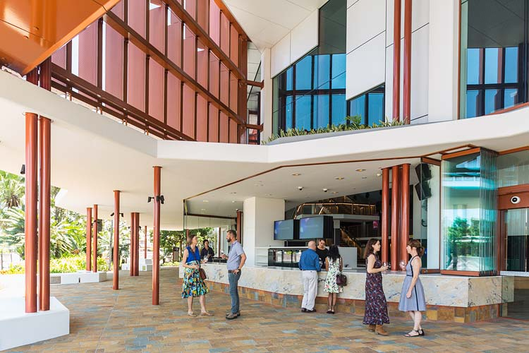 Theatre patrons socialising at the outdoor bar at Cairns Performing Arts Centre