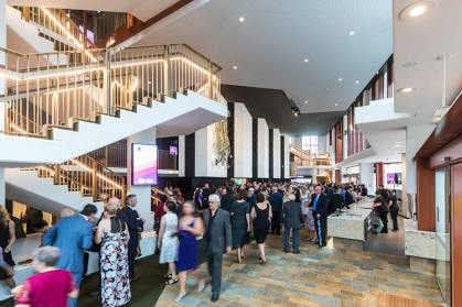 People gather inside the foyer of the Cairns Performing Arts Centre for opening night