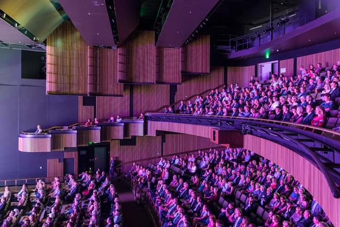Interior of main theatre of Cairns Performing Arts Centre with people watching performance