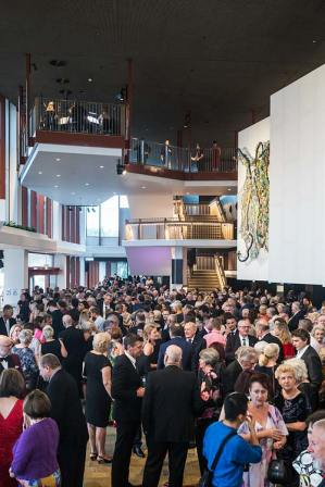 Theatre patrons socialising in the foyer area at Cairns Performing Arts Centre