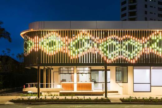 Exterior of Bulmba-ja Centre of Contemporary Arts in Cairns at night showing LED digital facade