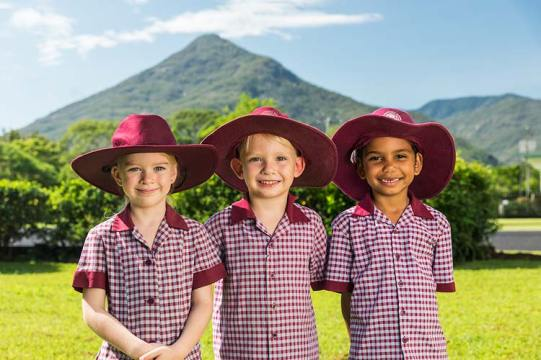 Group of smiling young school kids in uniform