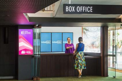 A customer getting tickets at Cairns Performing Arts Centre box office