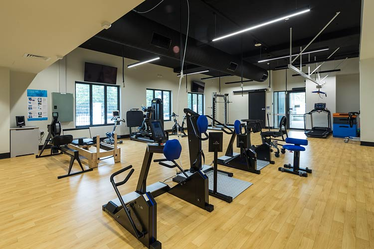 Gym room filled with exercise machines for spinal rehabilitation