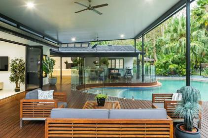 Outdoor entertaining area and pool deck of residential home