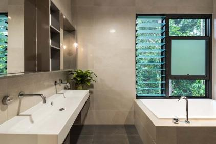 Bathroom interior with basin, bath and views of surrounding rainforest