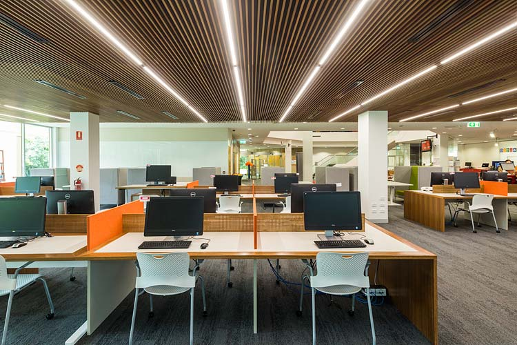 Interior of the James Cook University library showing online research seating