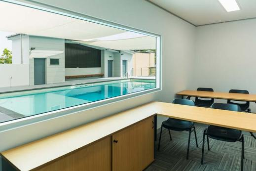 Interior of the Quicksilver Dive Centre showing view from training room to pool