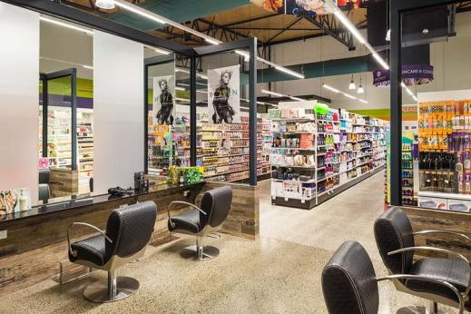 Interior of the Barr St Markets building showing hairdressing salon and pharmacy shelves