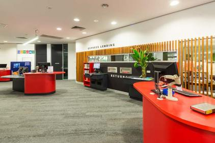 Interior of the James Cook University library showing book lending area