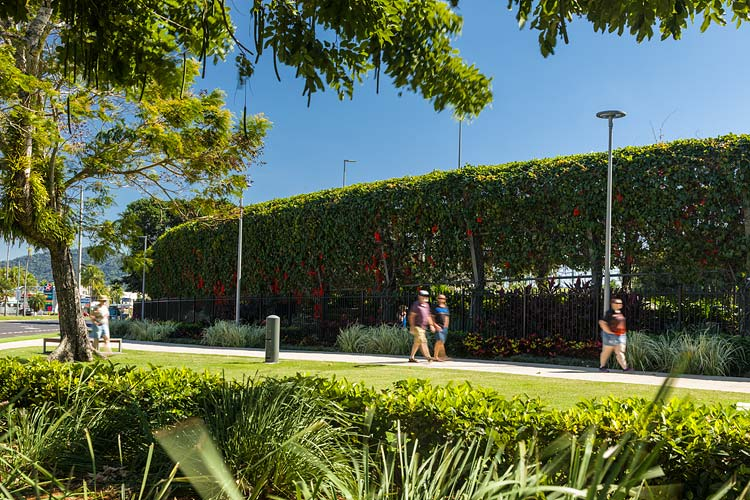 Visitors walking past the exterior of the vine covered arbour walkway at the Munro Martin Parklands