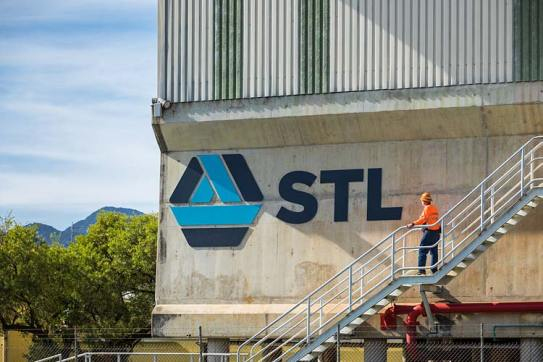 A worker looking at STL branding at the Cairns Sugar Terminal