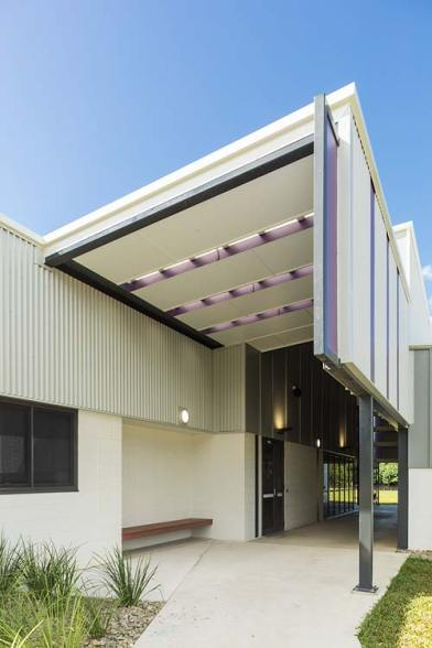 Exterior of new school building with angled roofline over entrance