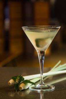 A martini cocktail featuring lemongrass and kaffir lime leaves