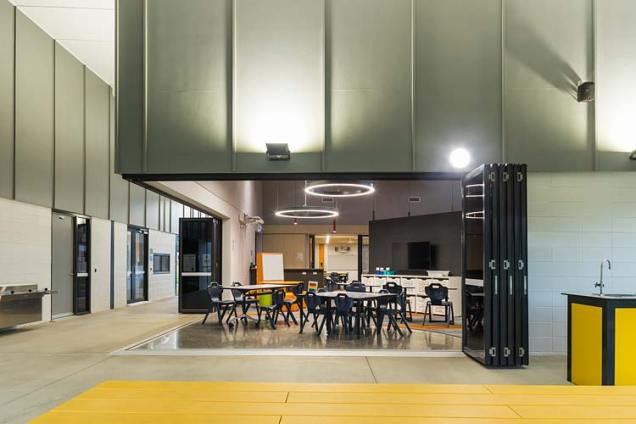 Interior of new school learning precinct with view through to open classroom