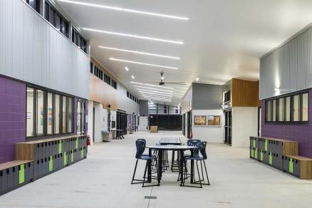 Interior of new school building showing central avenue with classrooms on both sides