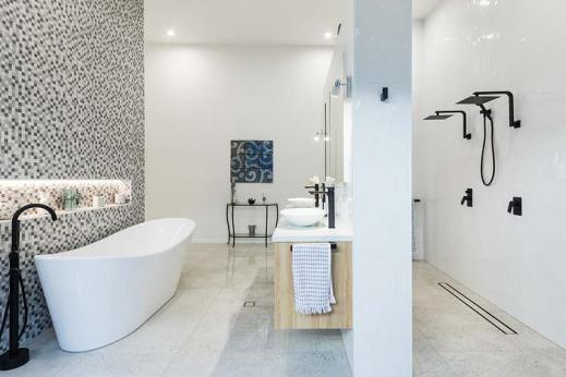 Residential home interior with view of bath and shower areas