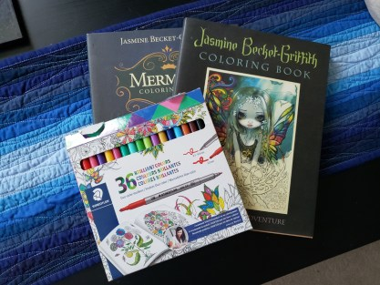 Two of my coloring books and my favorite set of markers