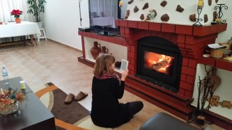 reading by the fire, keeping warm in January.