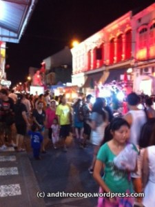 We visited the Walking Street in Phuket Town. More on this on Friday. I just figured I would share my really bad blurry photo from it to entice you. :)