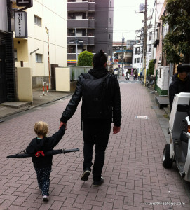 Chad and Z on our first walk down the street in Tokyo. Z is prepared for anything with her samurai sword umbrella.