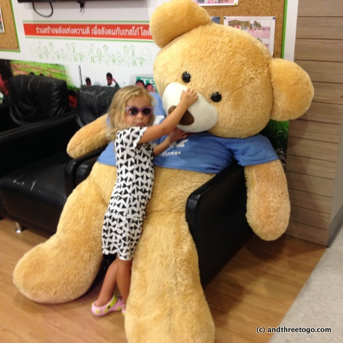 Z and a giant bear at the Tesco Lotus near our house.