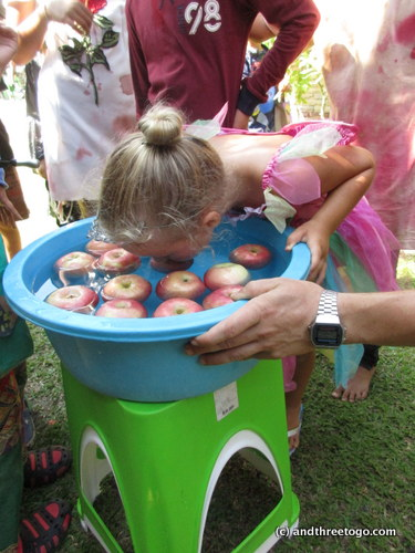 Z bobbing for apples at her school party... she did pretty good!