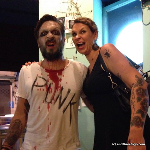 """Chad and I dressed up and went out for the night! I put some spider temporary tattoos all over my face arms and neck. Chads costume =""""Punk is dead""""."""