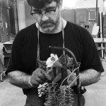 Rader working in sculpture studio.