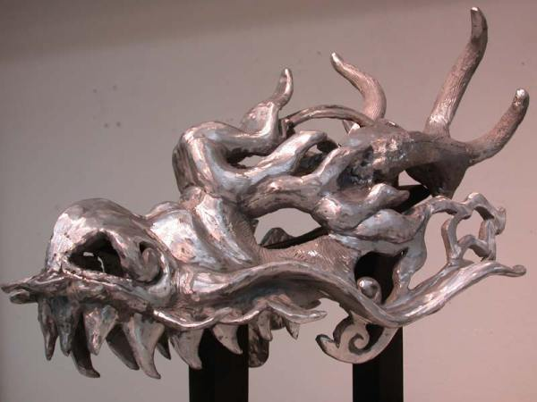 Aluminum casting in early stages of finishing and polishing.